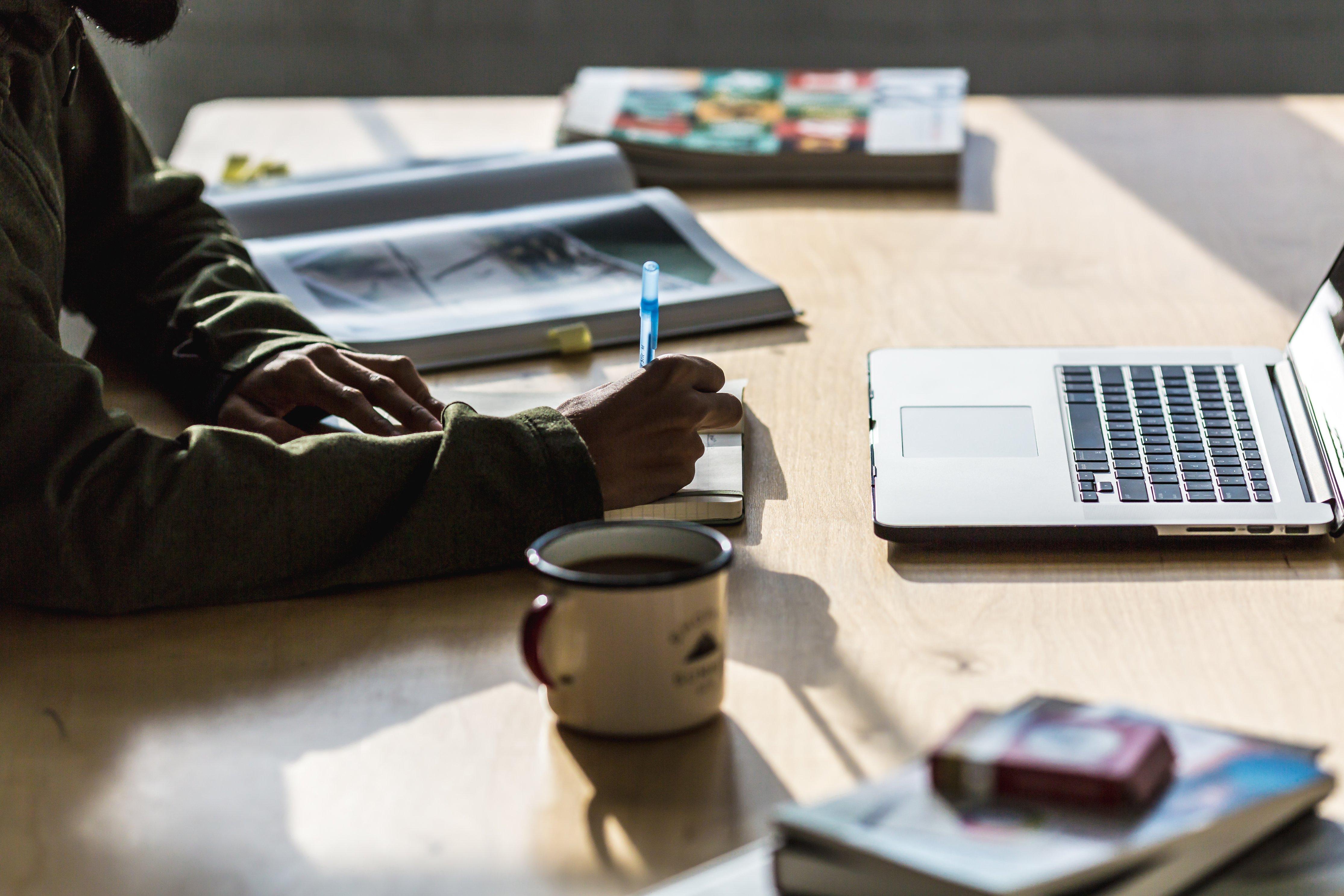 working files_man-writing-at-desk_
